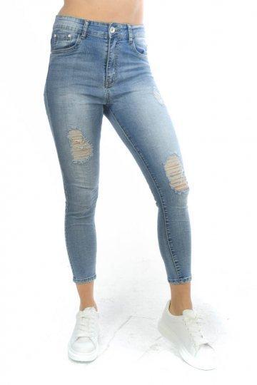 Τζιν μπλε παντελόνι με τύπου μπαλώματα μπροστά και σκισίματα.